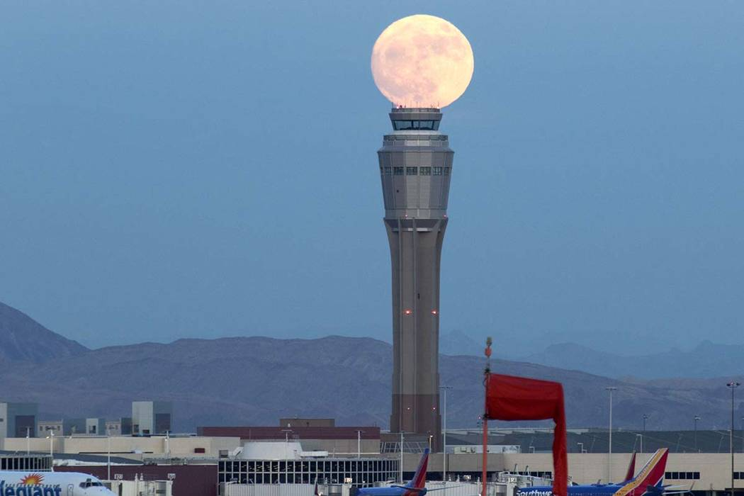 December's nearly full moon rises over the air traffic control tower at McCarran International Airport in Las Vegas Saturday, Dec. 2, 2017. (Richard Brian/Las Vegas Review-Journal) @vegasphotograph