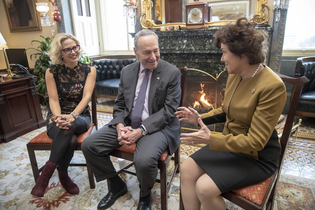 Senate Minority Leader Chuck Schumer, D-N.Y., center, welcomes newly-elected Democratic senators Kyrsten Sinema of Arizona, left, and Jacky Rosen of Nevada, at the Capitol in Washington, Tuesday, ...