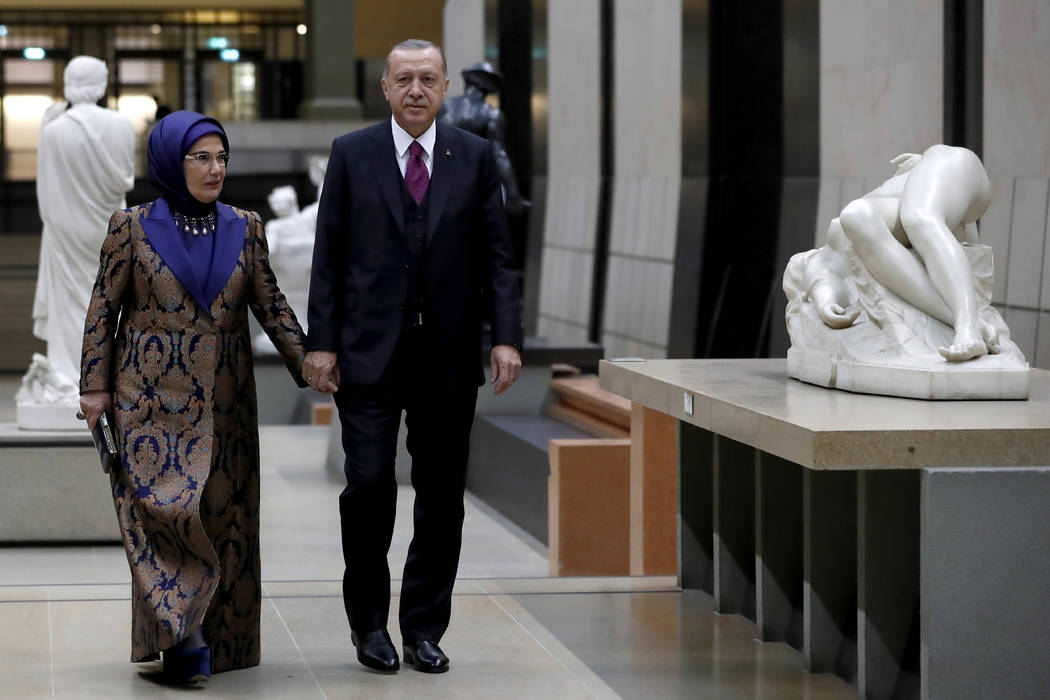 President of Turkey Recep Tayyip Erdogan and his wife Emine Erdogan arrive at the official dinner on the eve of the international ceremony for the Centenary of the WWI Armistice of 11 November 191 ...