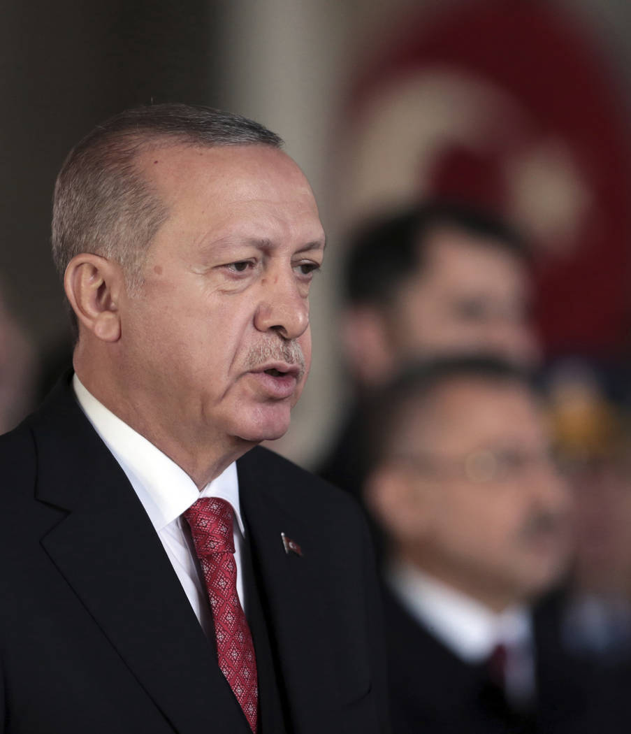 In this photo taken Saturday, Nov. 10, 2018, Turkish President Recep Tayyip Erdogan attends a ceremony at the mausoleum of Turkey's founder Mustafa Kemal Ataturk, in Ankara, Turkey. Erdogan said M ...