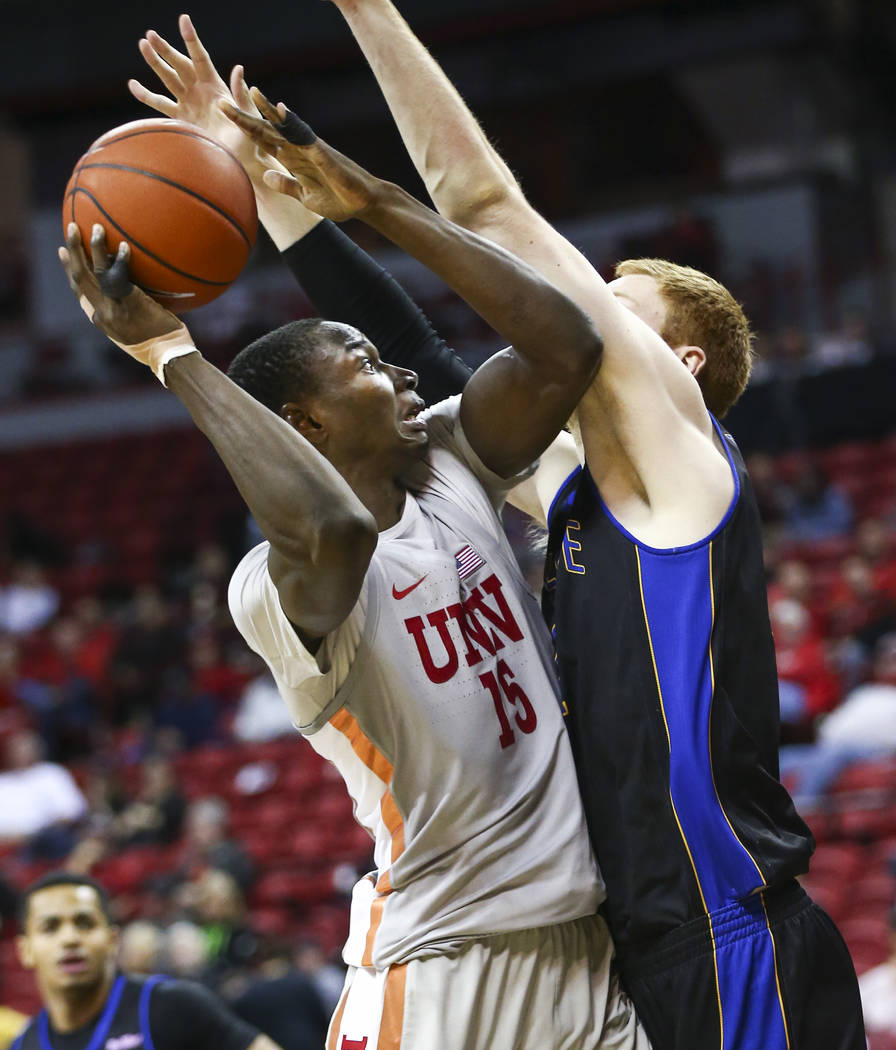 UNLV Rebels forward Cheickna Dembele (15) looks to pass under pressure from UC Riverside Highlanders guard Dominick Pickett (22) during the second half of a basketball game at the Thomas & Mac ...