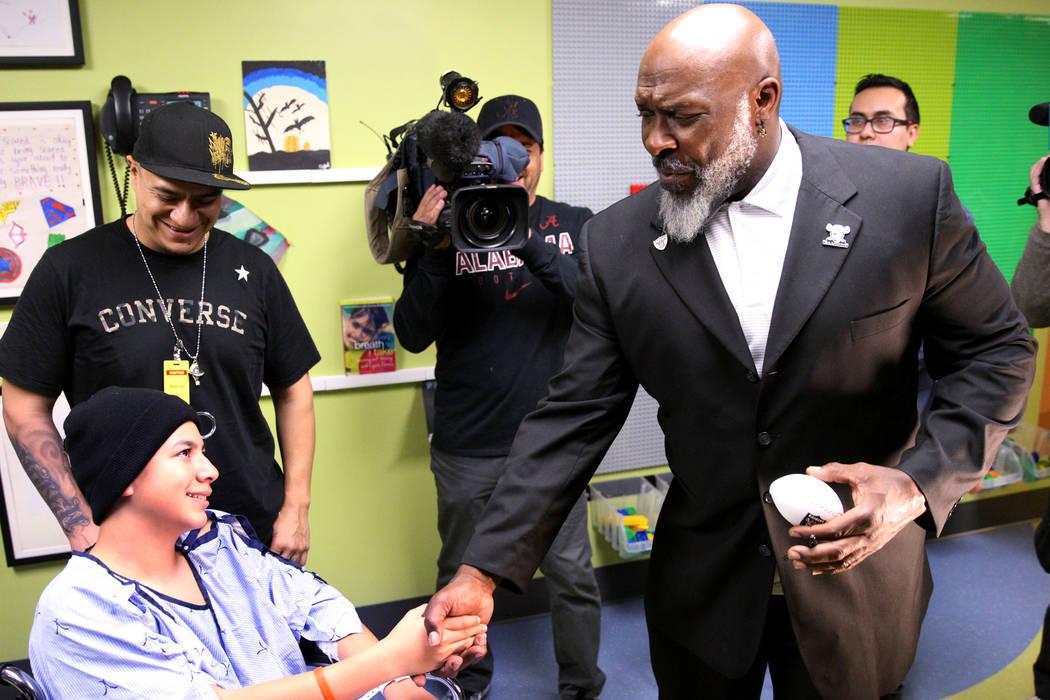 Raiders alumnus Roy Hart Jr. visits Andrew Velasco, 12, and his father Cisco at University Medical Center Children's Hospital in Las Vegas Tuesday, Nov. 13, 2018. K.M. Cannon Las Vegas Review-Jour ...