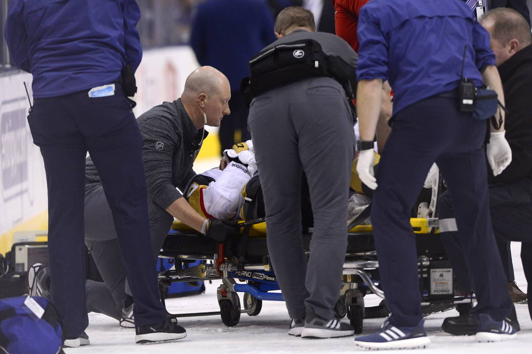 Vegas Golden Knights center Erik Haula (56) is taken off the ice on a stretcher after taking a hit along the boards during the third period of an NHL hockey game against the Toronto Maple Leafs on ...