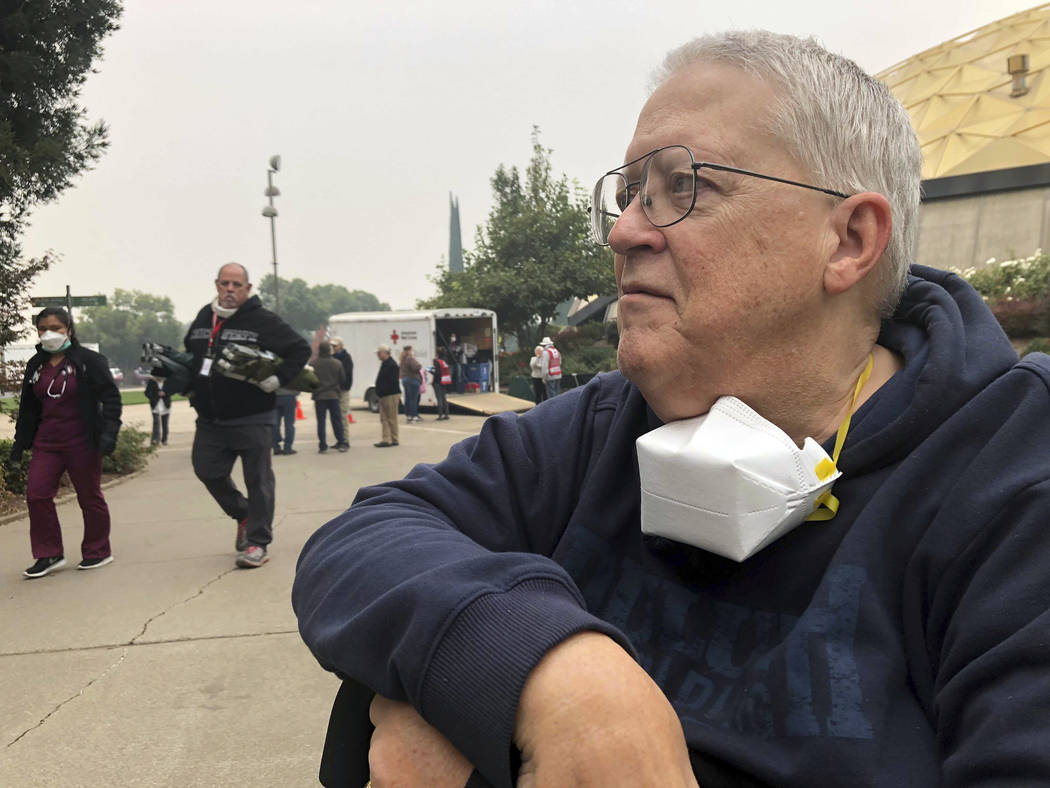Wildfire evacuee Harold Taylor is show at a shelter in Chico, Calif., Tuesday, Nov. 13, 2018. Taylor, a 72-year-old Vietnam veteran who walks with a cane, said he received a call on Thursday morni ...