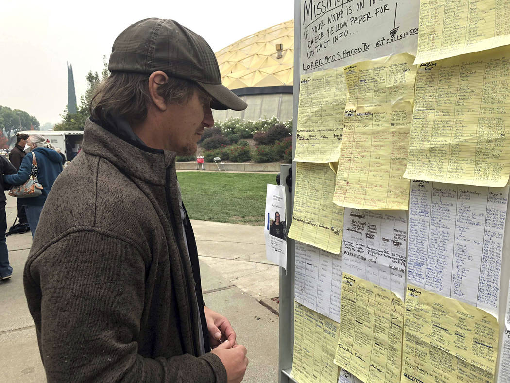 Wildfire evacuee Greg Gibson looks for information about his missing neighbors at The Neighborhood Church in Chico, Calif., on Tuesday, Nov. 13, 2018. The fire exploded so quickly, Gibson said, th ...