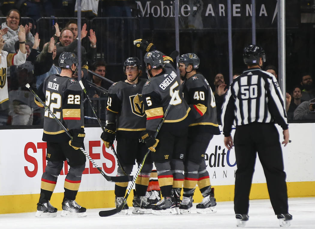Golden Knights players celebrate the second goal by Golden Knights center Cody Eakin, second from left, during the second period of an NHL hockey game against the Anaheim Ducks at T-Mobile Arena i ...