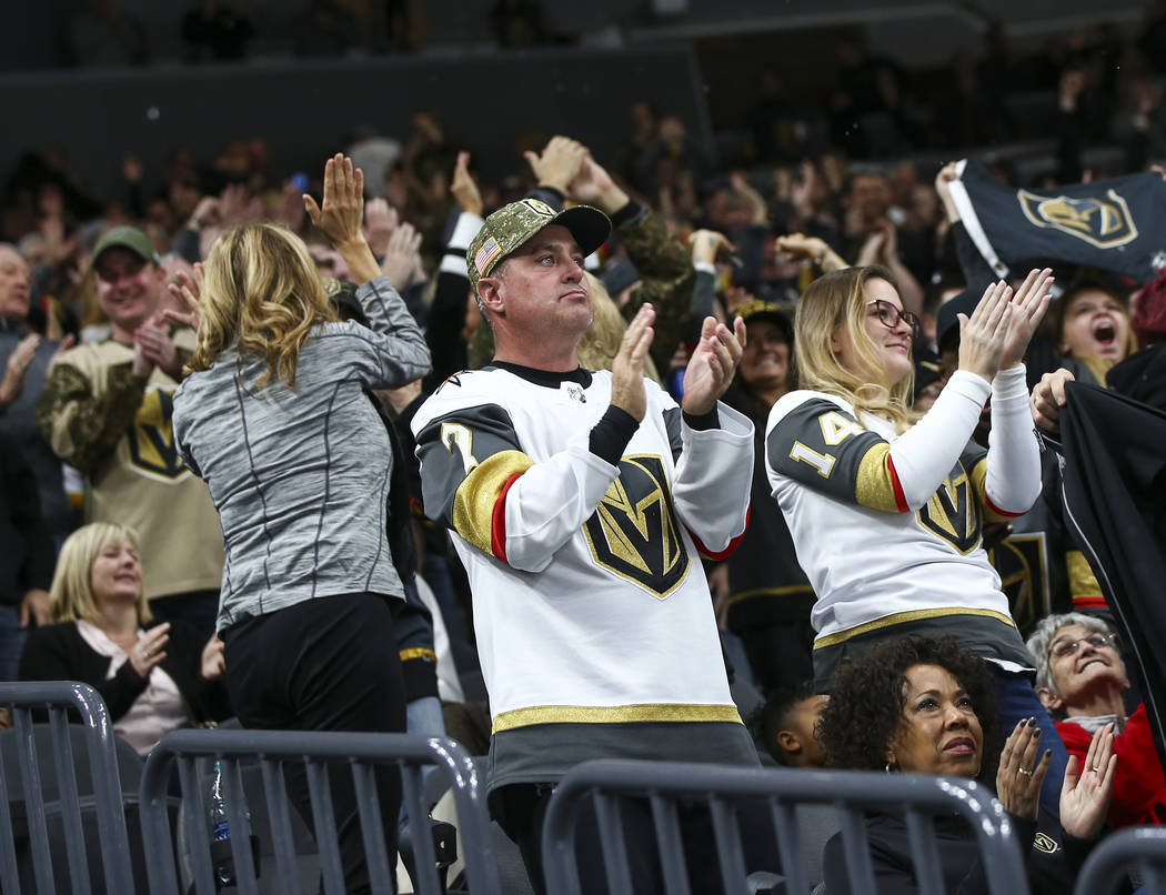 Golden Knights fans celebrate a goal by Golden Knights right wing Alex Tuch, not pictured, during the first period of an NHL hockey game against the Anaheim Ducks at T-Mobile Arena in Las Vegas on ...