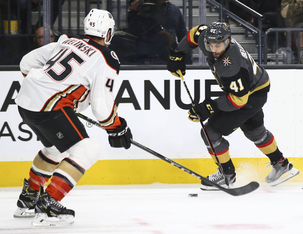 Golden Knights center Pierre-Edouard Bellemare (41) looks to send the puck past Anaheim Ducks defenseman Andy Welinski (45) during the first period of an NHL hockey game at T-Mobile Arena in Las V ...