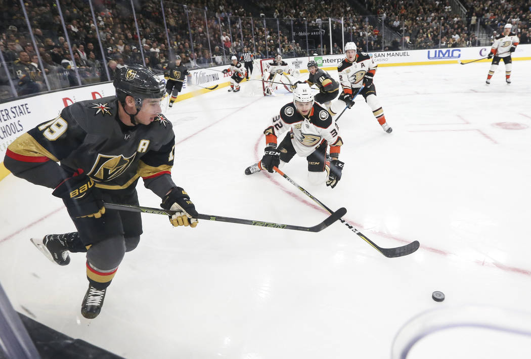 Golden Knights right wing Reilly Smith (19) and Anaheim Ducks defenseman Jacob Larsson (32) go after the puck during the first period of an NHL hockey game at T-Mobile Arena in Las Vegas on Wednes ...