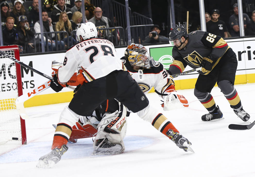 Golden Knights right wing Alex Tuch (89) gets the puck past Anaheim Ducks goaltender John Gibson (36) to score a goal during the first period of an NHL hockey game at T-Mobile Arena in Las Vegas o ...