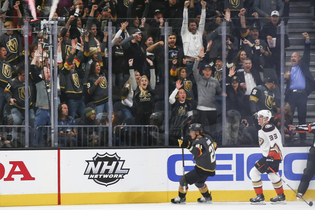 Golden Knights fans celebrate a goal by Golden Knights center Cody Eakin (21) during the second period of an NHL hockey game against the Anaheim Ducks at T-Mobile Arena in Las Vegas on Wednesday, ...