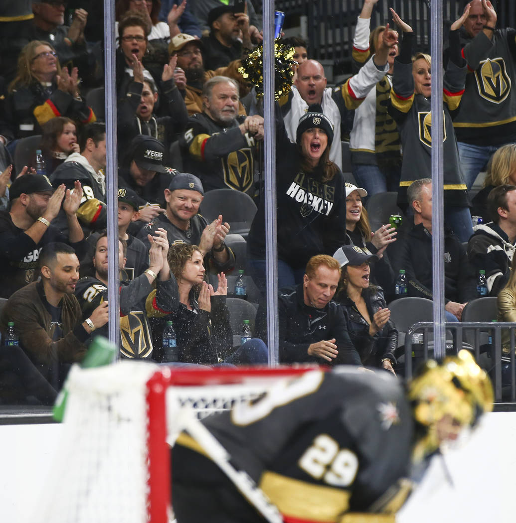 Golden Knights fans celebrate a series of blocks by Golden Knights goaltender Marc-Andre Fleury (29) during the second period of an NHL hockey game against the Anaheim Ducks at T-Mobile Arena in L ...