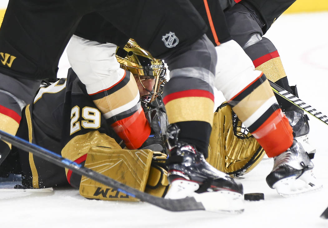Golden Knights goaltender Marc-Andre Fleury (29) reaches out to block the puck after losing control of his stick during the second period of an NHL hockey game at T-Mobile Arena in Las Vegas on We ...