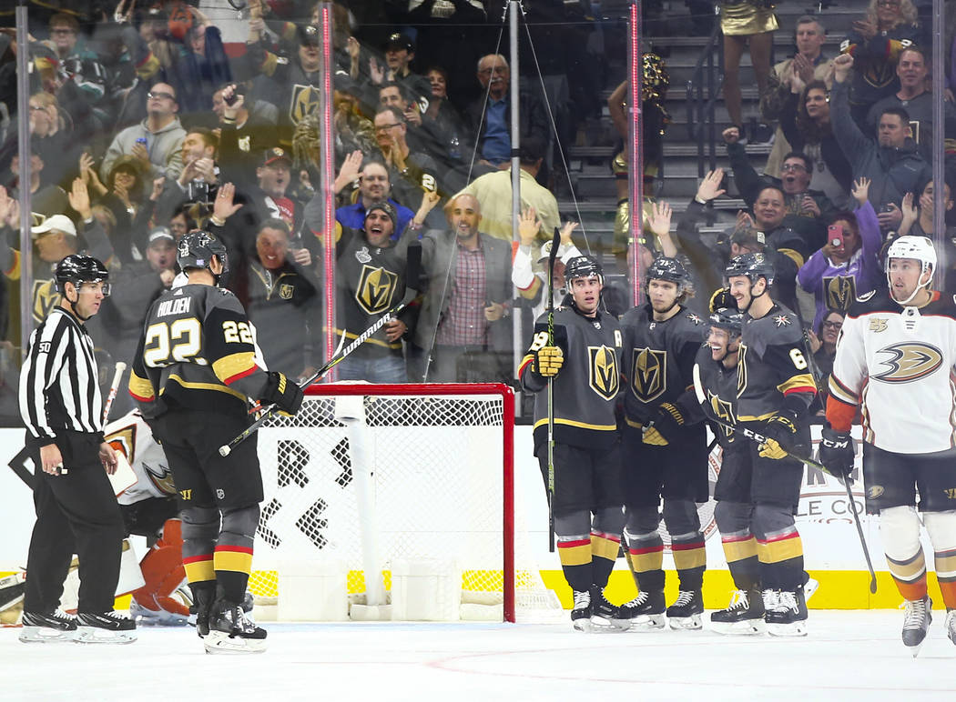 Golden Knights players celebrate a goal by Golden Knights defenseman Nick Holden (22) during the second period of an NHL hockey game against the Anaheim Ducks at T-Mobile Arena in Las Vegas on Wed ...