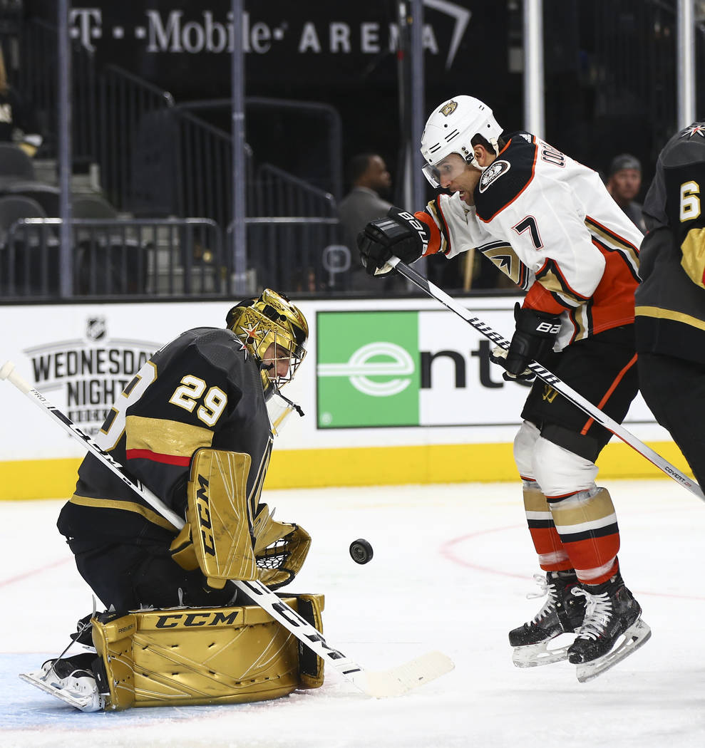 Golden Knights goaltender Marc-Andre Fleury (29) blocks a shot in front of Anaheim Ducks left wing Andrew Cogliano (7) during the second period of an NHL hockey game at T-Mobile Arena in Las Vegas ...