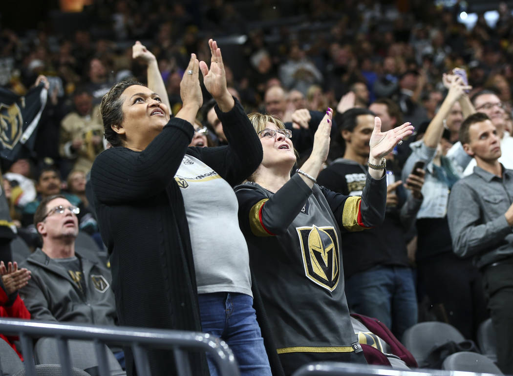 Golden Knights fans celebrate a goal by Golden Knights center Cody Eakin, not pictured, at the start of the second period of an NHL hockey game at T-Mobile Arena in Las Vegas on Wednesday, Nov. 14 ...