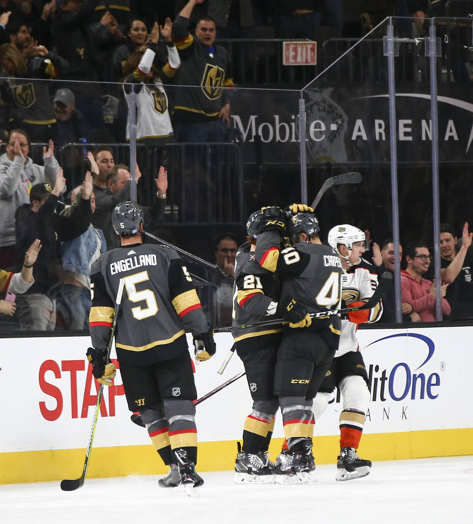 Golden Knights center Cody Eakin (21) celebrates his goal with teammate Ryan Carpenter (40) during the second period of an NHL hockey game against the Anaheim Ducks at T-Mobile Arena in Las Vegas ...