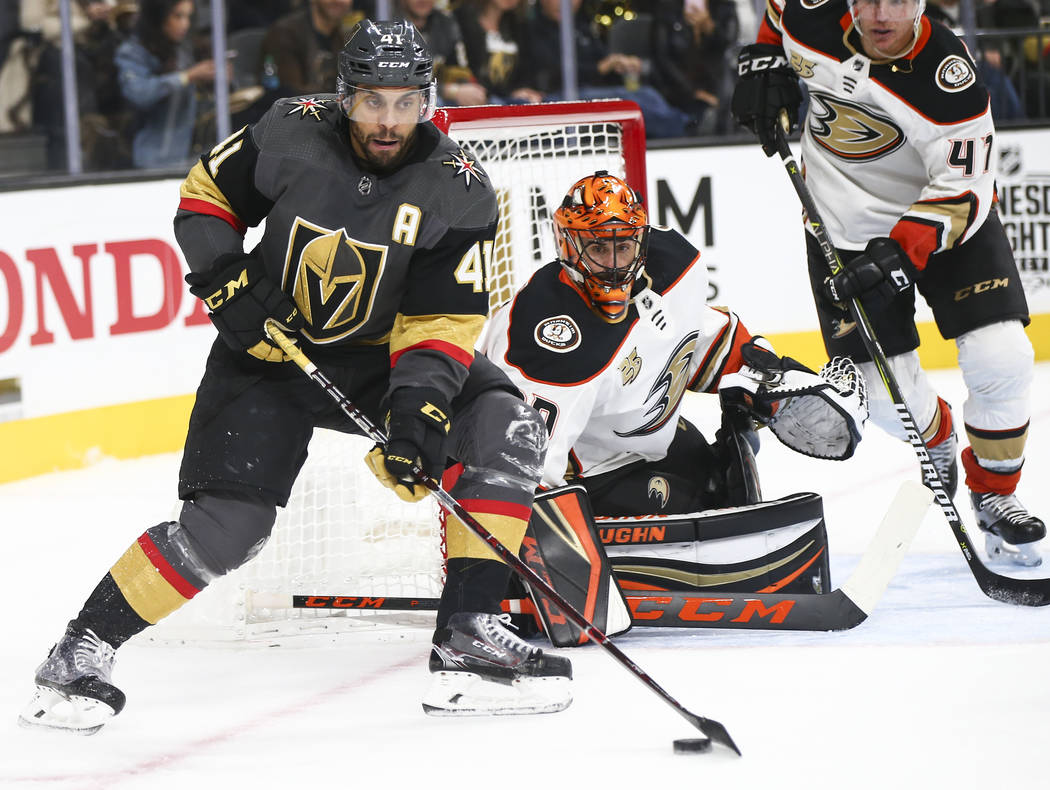 Golden Knights center Pierre-Edouard Bellemare (41) moves the puck in front of Anaheim Ducks goaltender Ryan Miller (30) during the third period of an NHL hockey game at T-Mobile Arena in Las Vega ...