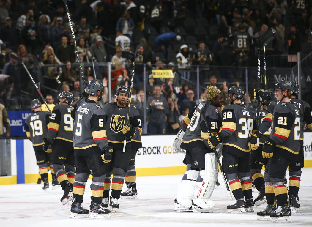 Golden Knights players celebrate their 5-0 victory over the Anaheim Ducks in an NHL hockey game at T-Mobile Arena in Las Vegas on Wednesday, Nov. 14, 2018. Chase Stevens Las Vegas Review-Journal @ ...
