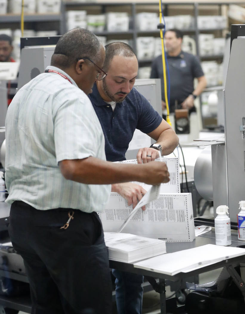 Employees at the Broward County Supervisor of Elections office count ballots during a recount, Wednesday, Nov. 14, 2018, in Lauderhill, Fla. (Wilfredo Lee/AP)