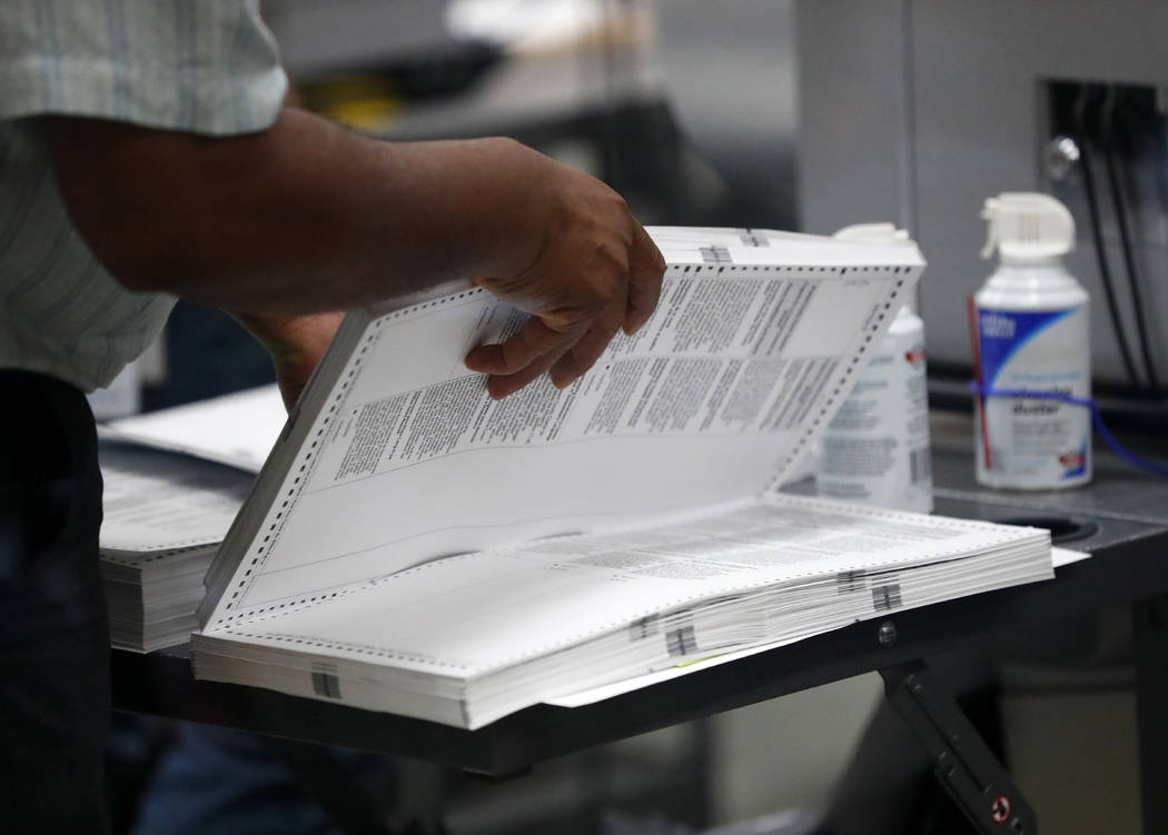An employee at the Broward County Supervisor of Elections office prepares to load a machine as they count ballots, Wednesday, Nov. 14, 2018, in Lauderhill, Fla. (Wilfredo Lee/AP)
