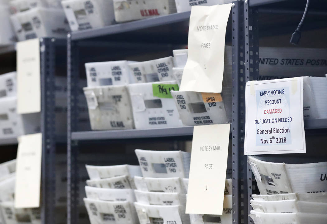 Bins filled with ballots are stacked at the Broward County Supervisor of Elections office as employees count ballots during a recount, Wednesday, Nov. 14, 2018, in Lauderhill, Fla. (Wilfredo Lee/AP)