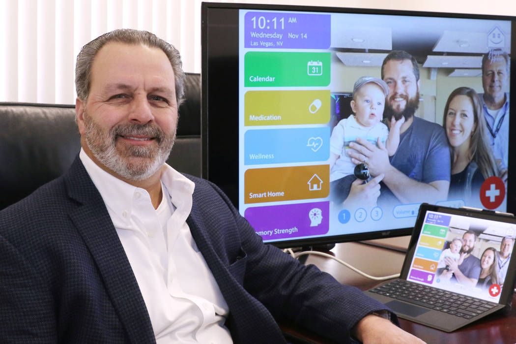 Anthony Rufo, president of HAPPIE Home, poses for a photo with a prototype of his product, Happie Home, at his Henderson office on Wednesday, Nov. 14, 2018. Happie Home is an in-home digital compa ...