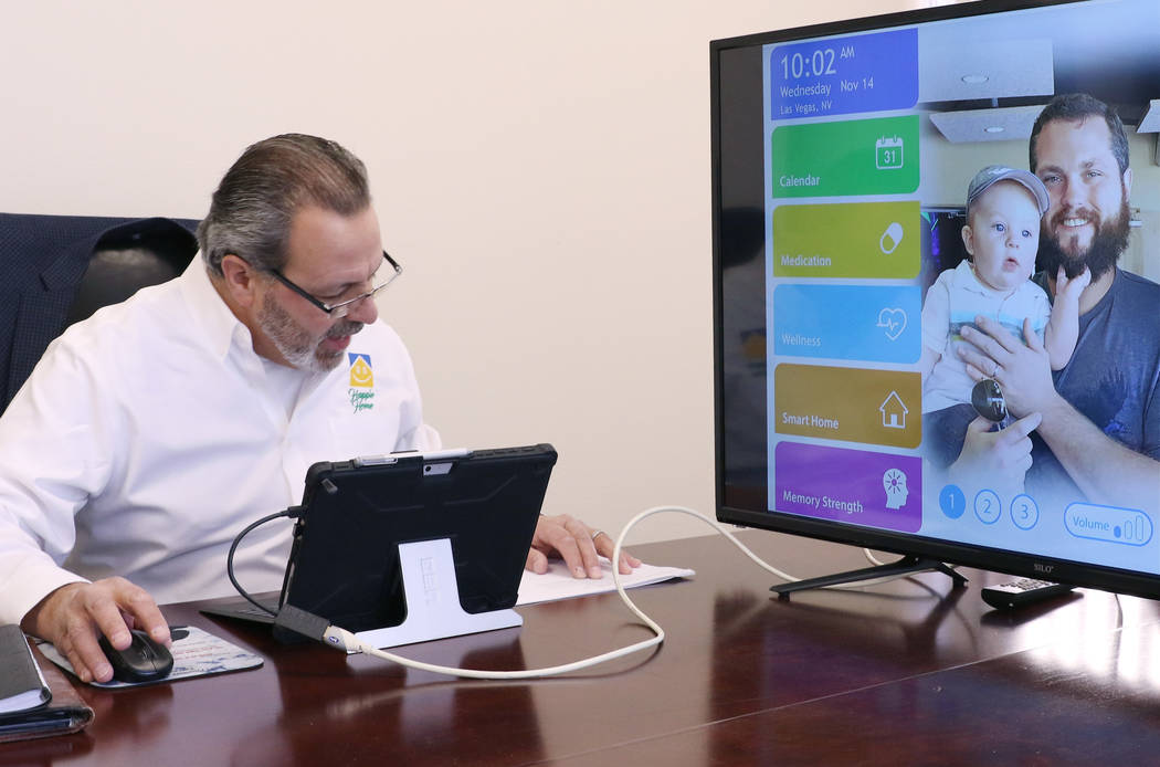 Anthony Rufo, president of HAPPIE Home, uses voice recognition technology to activate Happie Home, a new in-home digital companion, works at his Henderson office on Wednesday, Nov. 14, 2018. Happi ...
