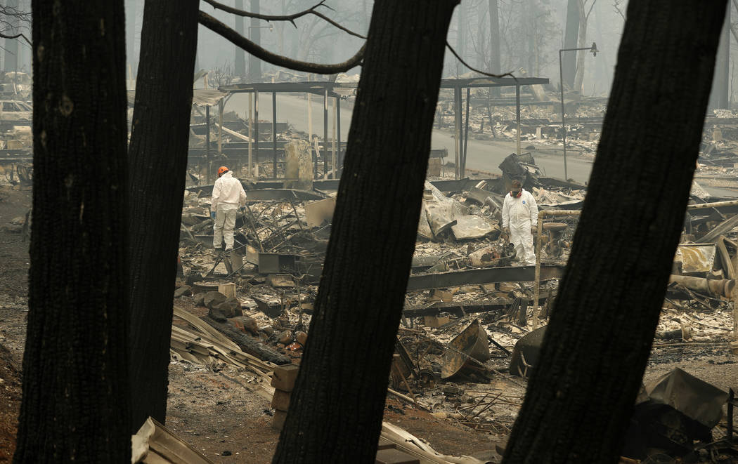 A search and rescue workers search for human remains at a burned out trailer park from the Camp fire, Tuesday, Nov. 13, 2018, in Paradise, Calif. The deadliest, most destructive blaze in Californi ...