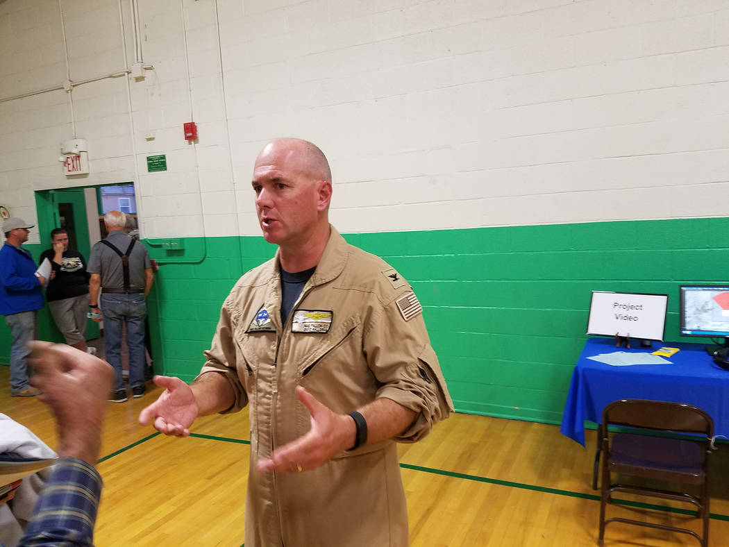 Capt. David Halloran, commanding officer of Naval Air Station Fallon, speaks to a crowd member in Gabbs on Oct. 7. A public meeting was on the proposed expansion of the Navy's Fallon Range Trainin ...