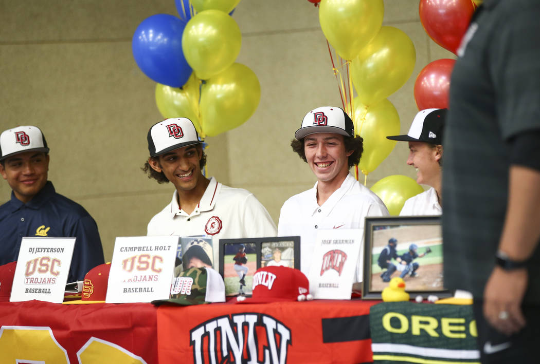 Desert Oasis baseball players, from left, Aaron Roberts, DJ Jefferson, Campbell Holt and Josh Sharman during signing day at Desert Oasis High School in Las Vegas on Wednesday, Nov. 14, 2018. Chase ...