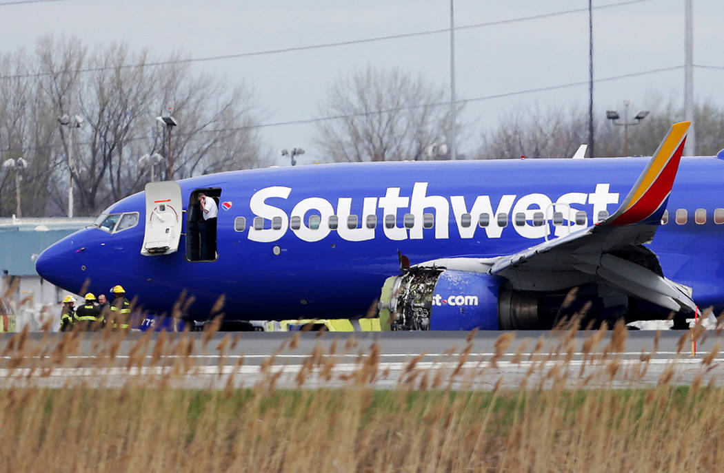 A Southwest Airlines plane sits on the runway at the Philadelphia International Airport after it made an emergency landing in Philadelphia on April 17, 2018. In new accounts released Wednesday, No ...