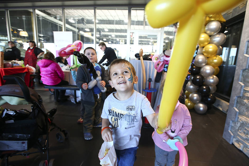 "Three-year-old Aidan Cahow holds up a balloon during the second annual ""Silver and Gold"" food drive at City National Arena in Las Vegas on Thursday, Nov. 15, 2018. Chase Stevens Las Vega ..."