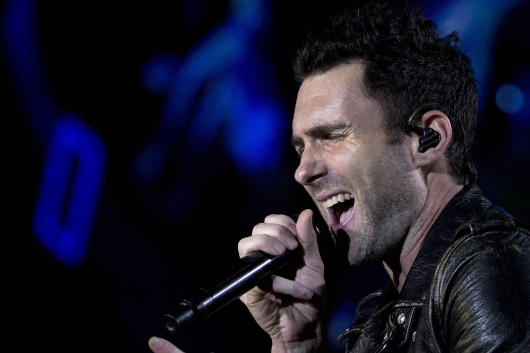 Adam Levine of Maroon 5 performs at the Rock in Rio music festival in Rio de Janeiro, Brazil, Saturday, Sept. 16, 2017. (AP Photo/Silvia Izquierdo)35