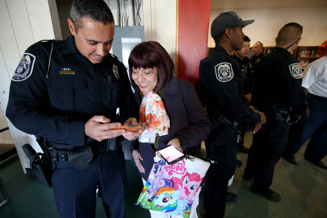 North Las Vegas Police officer Aaron Patty with Chantelle Stotler during an early Thanksgiving feast at Rose Gardens senior public housing complex in North Las Vegas Wednesday, Nov. 14, 2018. K.M. ...