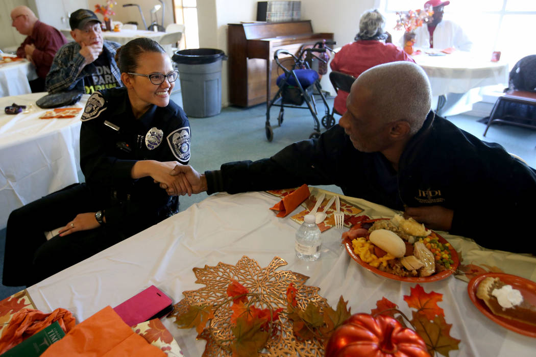 North Las Vegas Police officer J. Mangual meets James Brown during an early Thanksgiving feast at Rose Gardens senior public housing complex in North Las Vegas Wednesday, Nov. 14, 2018. K.M. Canno ...