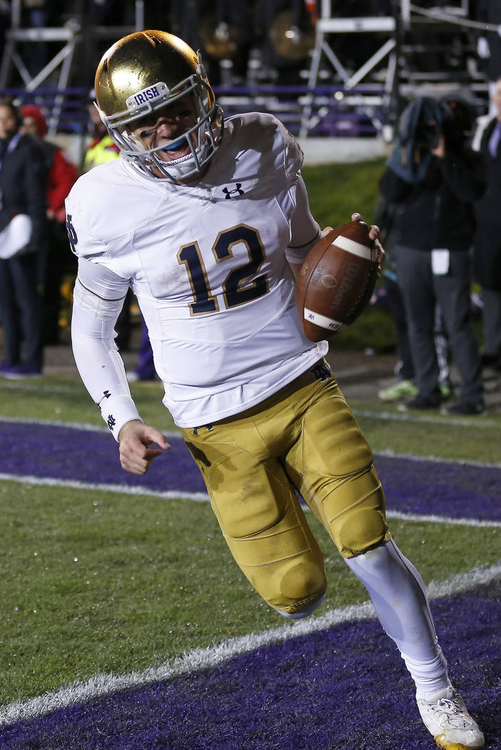 Notre Dame's Ian Book during the second half of an NCAA college football game Saturday, Nov. 3, 2018, in Evanston, Ill. (AP Photo/Jim Young)