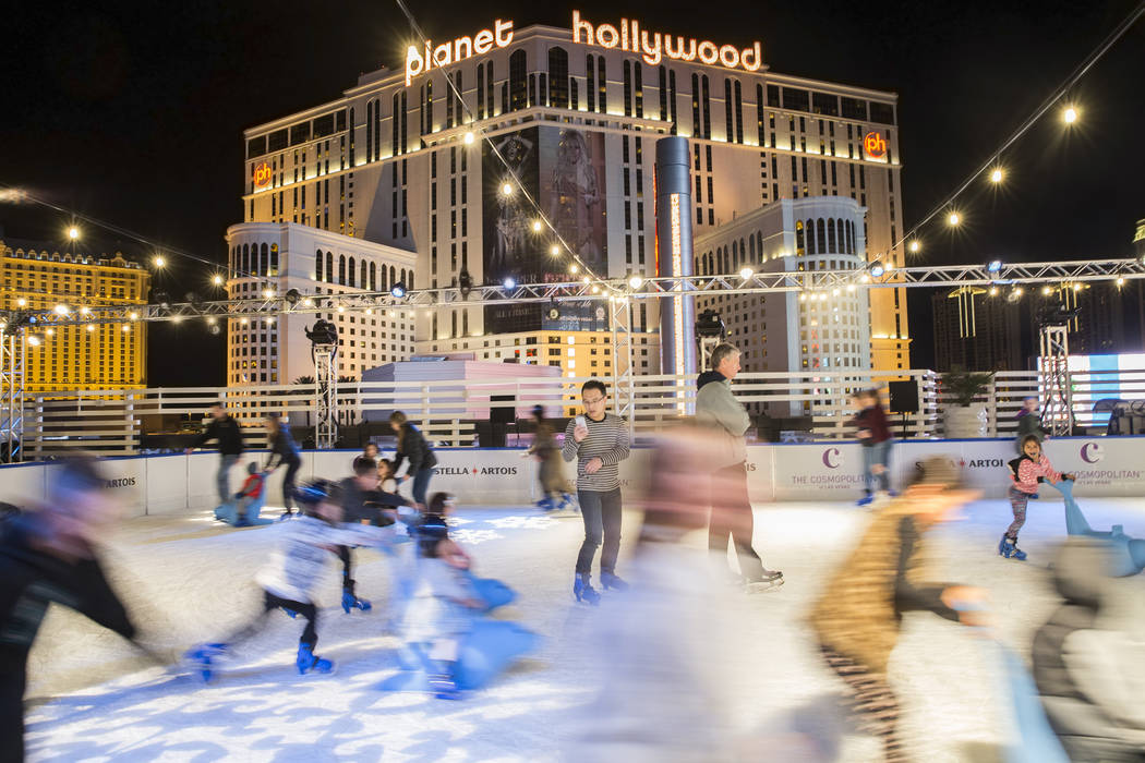 Skaters streak across the ice at night at the Cosmopolitan of Las Vegas Ice Rink on Monday, Nov. 21, 2016, in Las Vegas. (Benjamin Hager/Las Vegas Review-Journal)