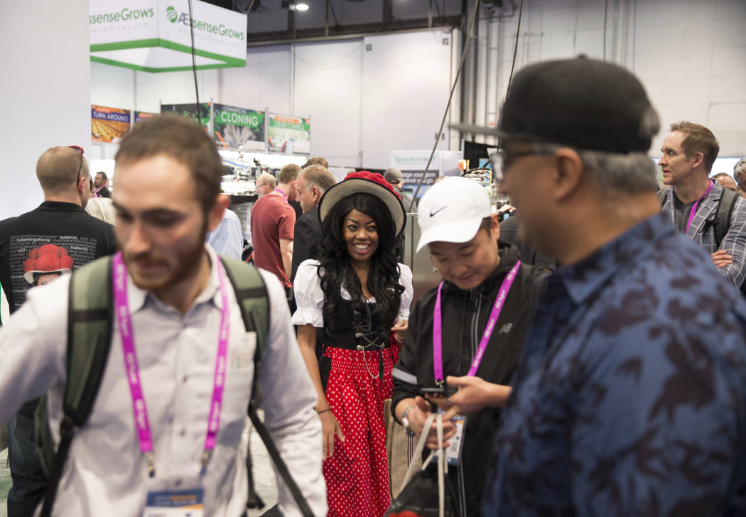 Huber saleswoman Chupy Macias, middle, talks with customers during MJBizCon on Wednesday, November 14, 2018, at the Las Vegas Convention Center, in Las Vegas. Benjamin Hager Las Vegas Review-Journal