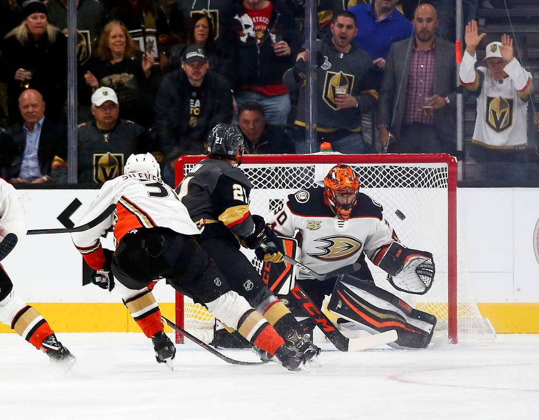 Golden Knights center Cody Eakin (21) scores his second goal past Anaheim Ducks goaltender Ryan Miller (30) during the second period of an NHL hockey game at T-Mobile Arena in Las Vegas on Wednesd ...
