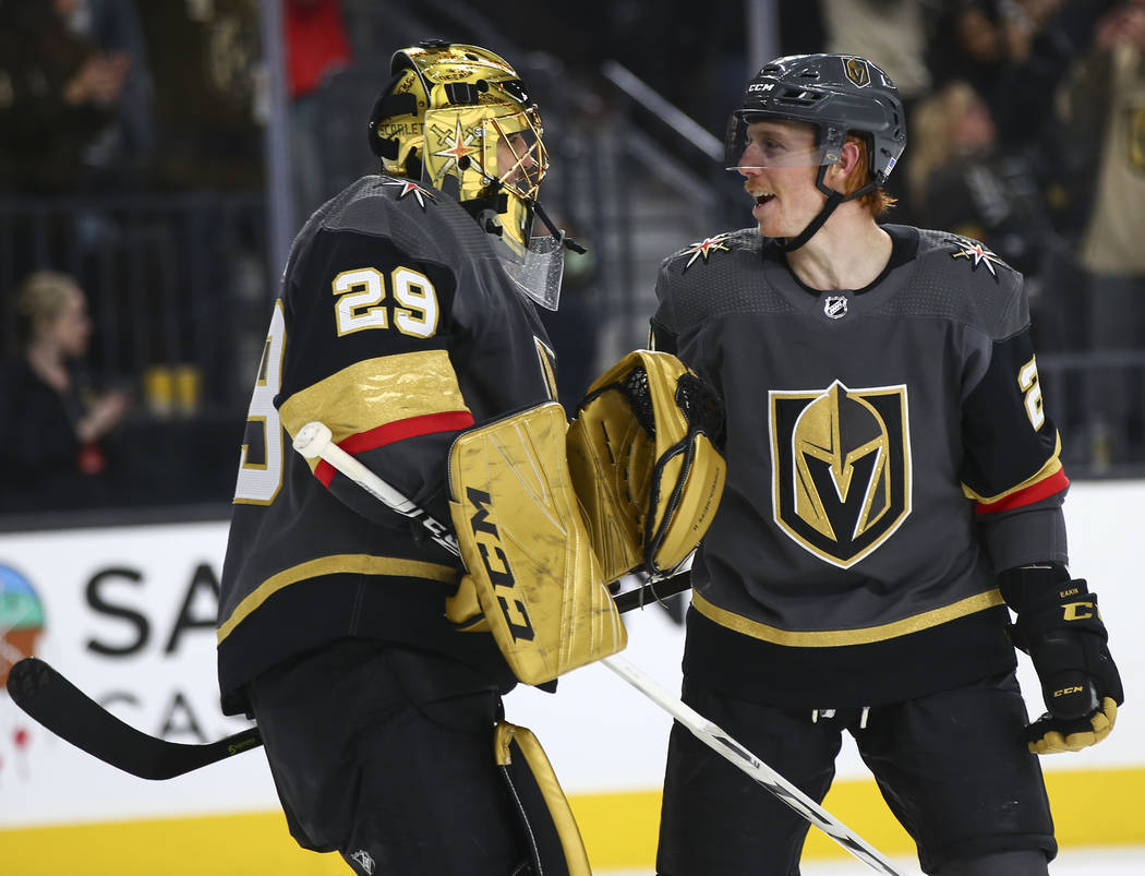 Golden Knights goaltender Marc-Andre Fleury (29) celebrates a goal by Golden Knights center Cody Eakin during the second period of an NHL hockey game against the Anaheim Ducks at T-Mobile Arena in ...