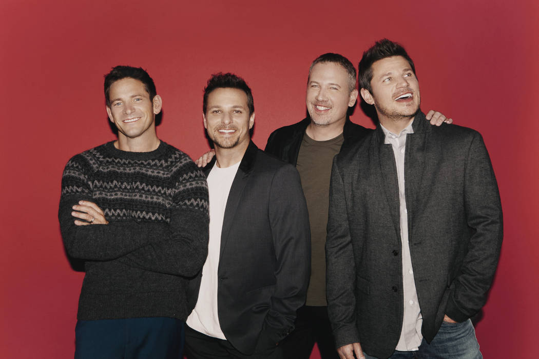 Member of 98 Degrees are shown, from left: Jeff Timmons, Drew Lachey, Justin Jeffre and Nick Lachey. (Elias Tahan)