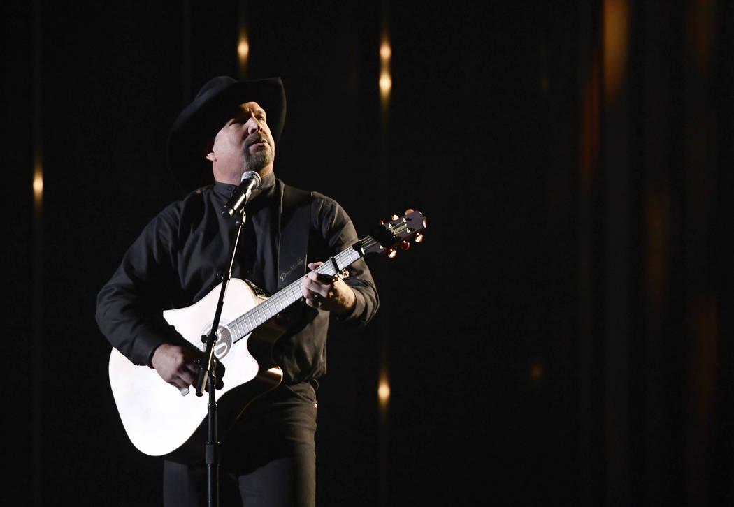 """Garth Brooks performs """"Stronger Than Me"""" at the 52nd annual CMA Awards at Bridgestone Arena on Wednesday, Nov. 14, 2018, in Nashville, Tenn. (Photo by Charles Sykes/Invision/AP)"""