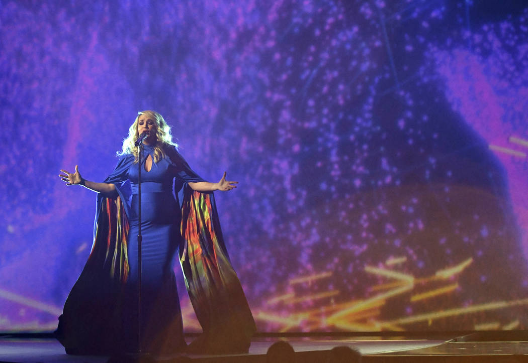 """Carrie Underwood performs """"Love Wins"""" at the 52nd annual CMA Awards at Bridgestone Arena on Wednesday, Nov. 14, 2018, in Nashville, Tenn. (Photo by Charles Sykes/Invision/AP)"""