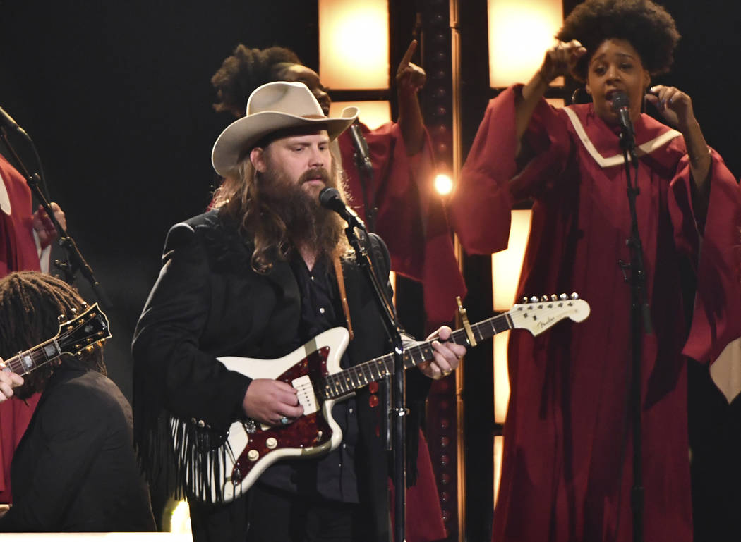 """Chris Stapleton performs """"I'll Take You There"""" at the 52nd annual CMA Awards at Bridgestone Arena on Wednesday, Nov. 14, 2018, in Nashville, Tenn. (Photo by Charles Sykes/Invision/AP)"""