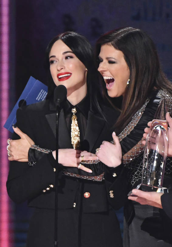 """Karen Fairchild of Little Big Town, right, embraces Kacey Musgraves?, winner of the award for album of the year for """"Golden Hour"""" at the 52nd annual CMA Awards at Bridgestone Arena on We ..."""