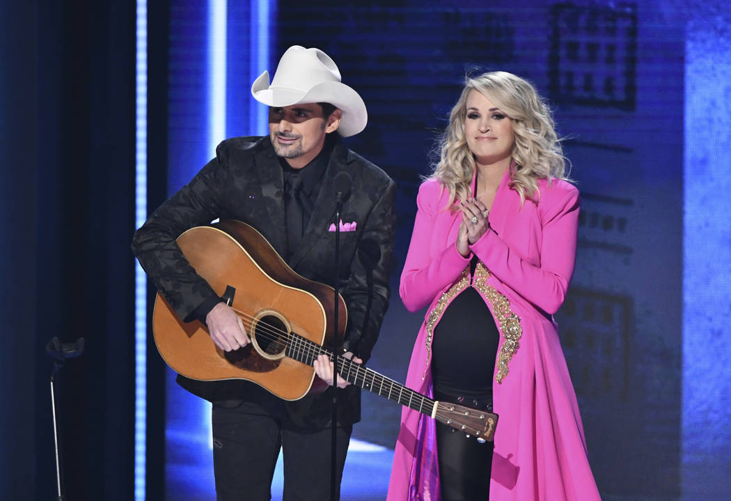 Hosts Brad Paisley, left, and Carrie Underwood appear at the 52nd annual CMA Awards at Bridgestone Arena on Wednesday, Nov. 14, 2018, in Nashville, Tenn. (Photo by Charles Sykes/Invision/AP)