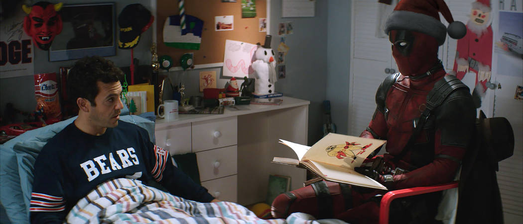 """Fred Savage, left, and Ryan Reynolds appear in a scene from """"Once Upon a Deadpool."""" (Fox)"""