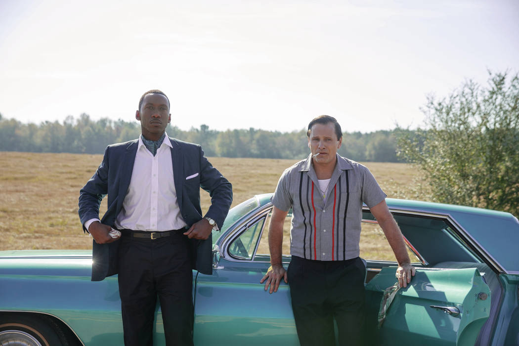 """Mahershala Ali as Dr. Donald Shirley and Viggo Mortensen as Tony Vallelonga in """"Green Book,"""" directed by Peter Farrelly. Photo Credit: Patti Perret/Universal Pictures, Participant, and DreamWorks"""