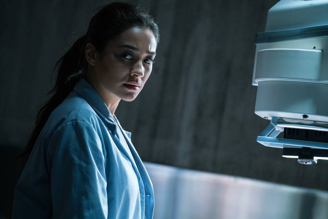 Megan (Shay Mitchell) prepares to intake the body just delivered in THE POSSESSION OF HANNAH GRACE. Claire Folger/SONY PICTURES ENTERTAINMENT